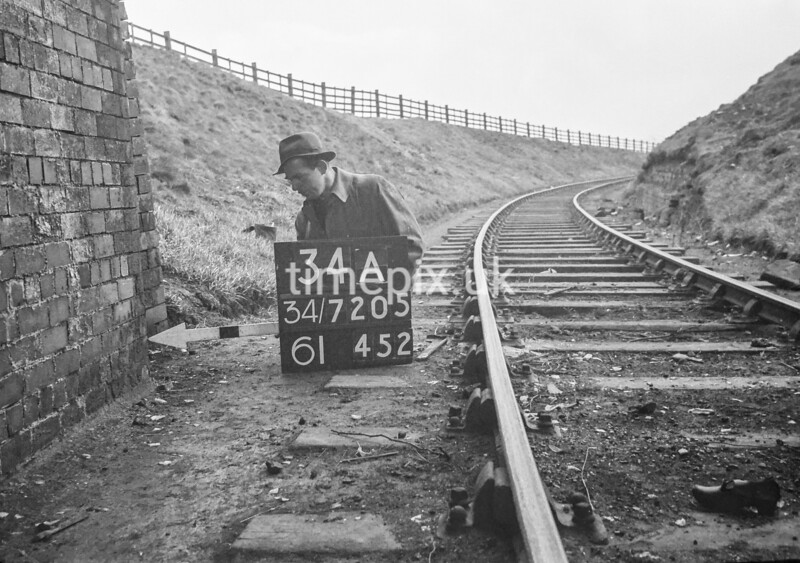 SD720534A, Man marking Ordnance Survey minor control revision point with an arrow in 1950s