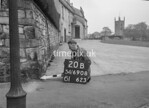 SD690820B, Man marking Ordnance Survey minor control revision point with an arrow in 1950s