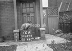 SD690772A, Man marking Ordnance Survey minor control revision point with an arrow in 1950s