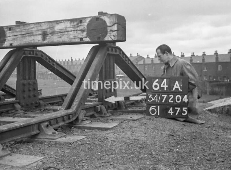 SD720464A, Man marking Ordnance Survey minor control revision point with an arrow in 1950s