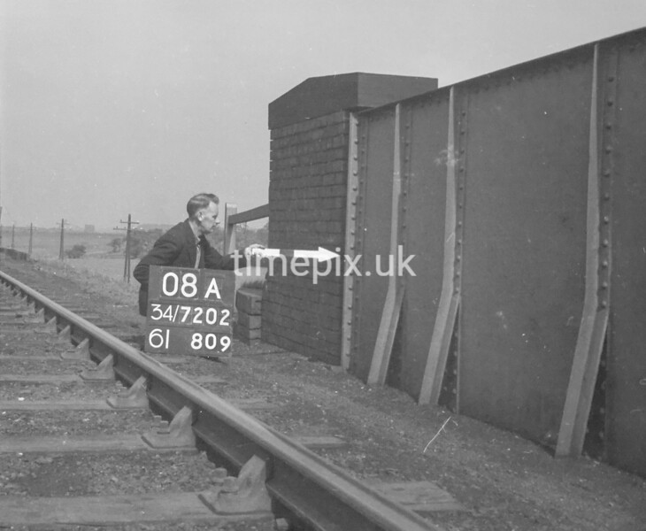 SD720208A, Man marking Ordnance Survey minor control revision point with an arrow in 1950s