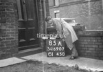 SD690785A, Man marking Ordnance Survey minor control revision point with an arrow in 1950s