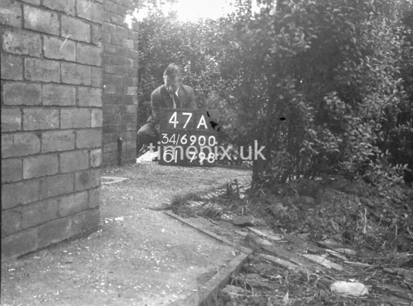 SD690047A, Man marking Ordnance Survey minor control revision point with an arrow in 1950s
