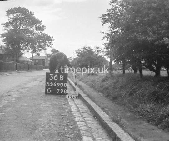 SD690036B, Man marking Ordnance Survey minor control revision point with an arrow in 1950s