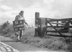 SD690051A, Man marking Ordnance Survey minor control revision point with an arrow in 1950s