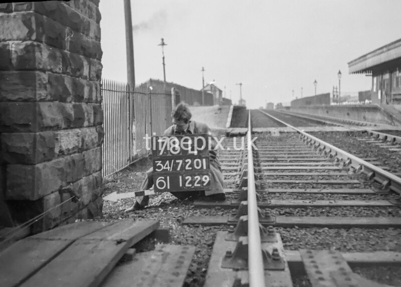 SD720178L, Man marking Ordnance Survey minor control revision point with an arrow in 1950s