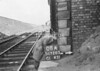 SD720508A, Man marking Ordnance Survey minor control revision point with an arrow in 1950s