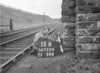 SD720415B, Man marking Ordnance Survey minor control revision point with an arrow in 1950s