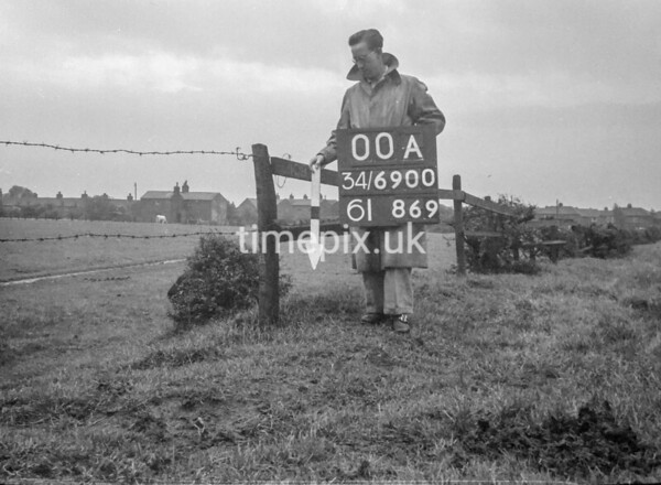 SD690000A, Man marking Ordnance Survey minor control revision point with an arrow in 1950s