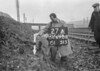 SD690827A, Man marking Ordnance Survey minor control revision point with an arrow in 1950s