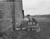 SD720468A, Man marking Ordnance Survey minor control revision point with an arrow in 1950s