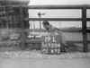 SD720419L, Man marking Ordnance Survey minor control revision point with an arrow in 1950s