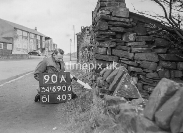 SD690690A, Man marking Ordnance Survey minor control revision point with an arrow in 1950s