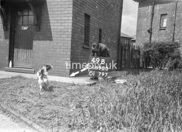 SD690049B, Man marking Ordnance Survey minor control revision point with an arrow in 1950s