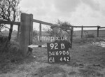 SD690692B, Man marking Ordnance Survey minor control revision point with an arrow in 1950s
