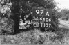 SD640697A, Man marking Ordnance Survey minor control revision point with an arrow in 1940s