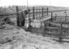 SD640522A, Man marking Ordnance Survey minor control revision point with an arrow in 1950s