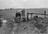SD630692B, Man marking Ordnance Survey minor control revision point with an arrow in 1950s