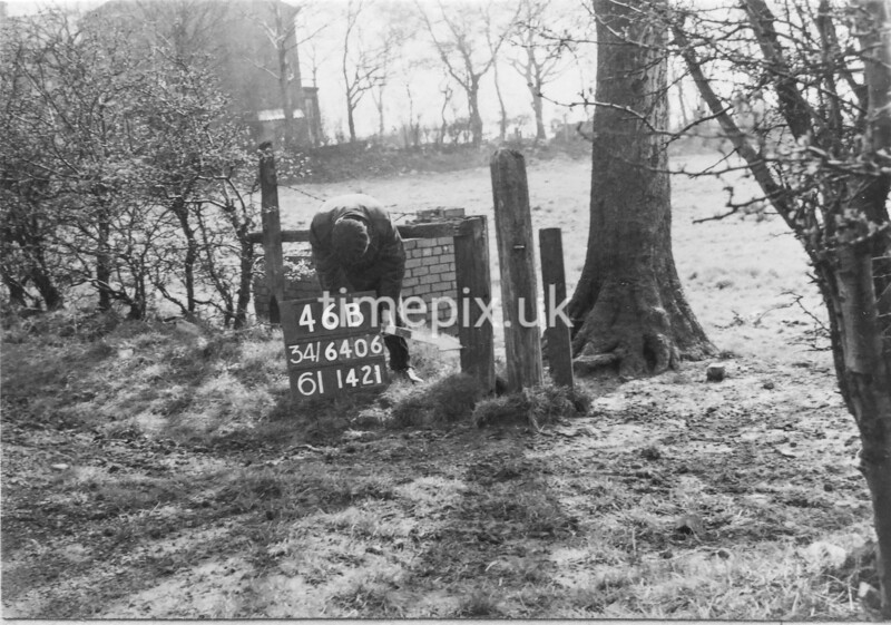 SD640646B, Man marking Ordnance Survey minor control revision point with an arrow in 1950s