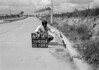 SD620467A, Man marking Ordnance Survey minor control revision point with an arrow in 1940s