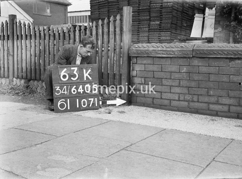 SD640563K, Man marking Ordnance Survey minor control revision point with an arrow in 1940s