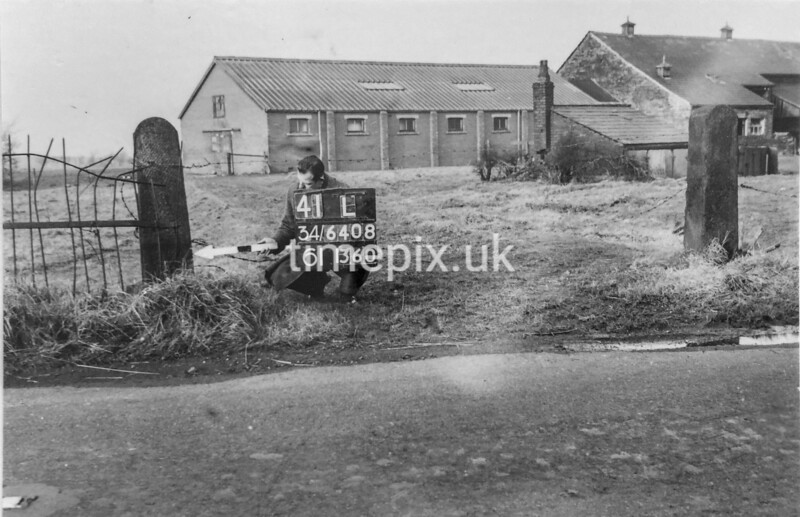 SD640841L, Man marking Ordnance Survey minor control revision point with an arrow in 1940s