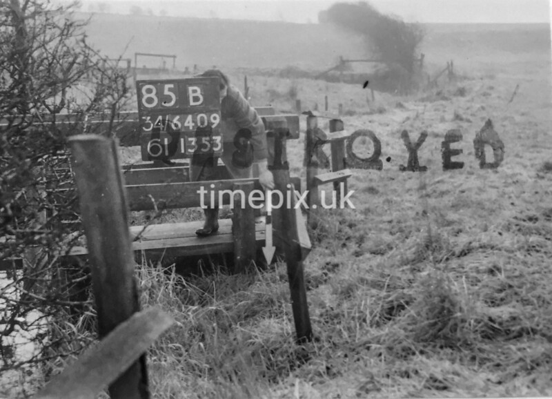SD640985B, Man marking Ordnance Survey minor control revision point with an arrow in 1940s