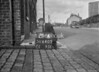 SD640521A, Man marking Ordnance Survey minor control revision point with an arrow in 1940s