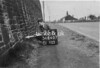SD640775B, Man marking Ordnance Survey minor control revision point with an arrow in 1940s