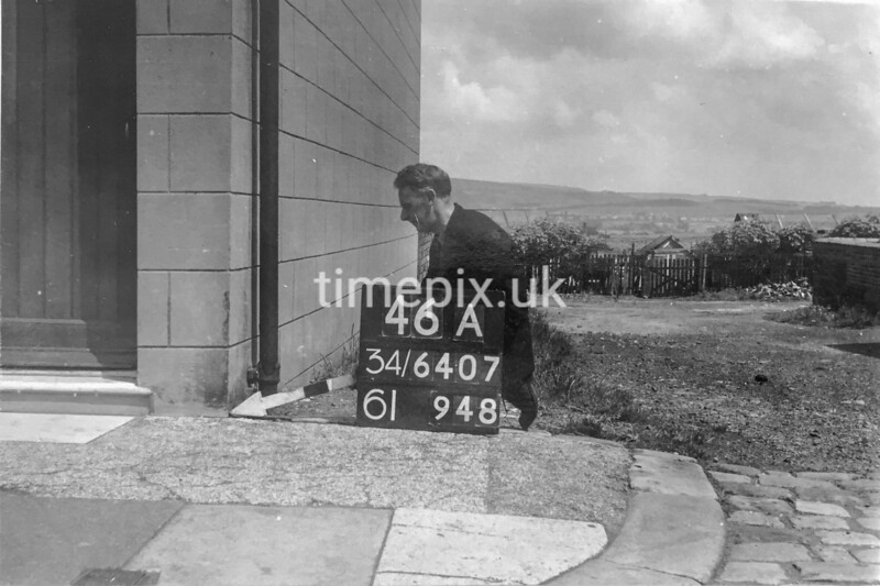 SD640746A, Man marking Ordnance Survey minor control revision point with an arrow in 1940s