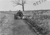 SD640884B, Man marking Ordnance Survey minor control revision point with an arrow in 1940s