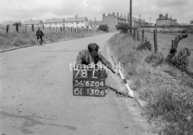 SD620478L, Man marking Ordnance Survey minor control revision point with an arrow in 1940s