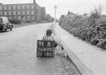 SD620591B, Man marking Ordnance Survey minor control revision point with an arrow in 1940s