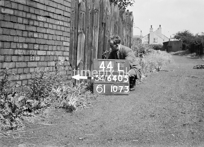 SD640544L, Man marking Ordnance Survey minor control revision point with an arrow in 1940s