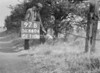 SD640497B, Man marking Ordnance Survey minor control revision point with an arrow in 1940s