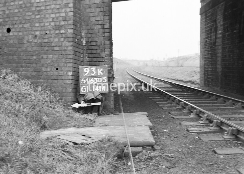 SD630593K, Man marking Ordnance Survey minor control revision point with an arrow in 1940s