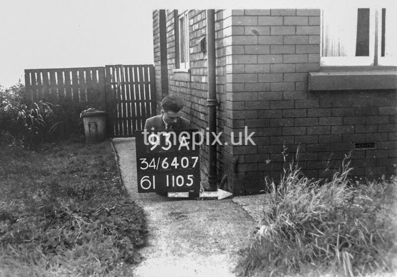 SD640793A, Man marking Ordnance Survey minor control revision point with an arrow in 1940s