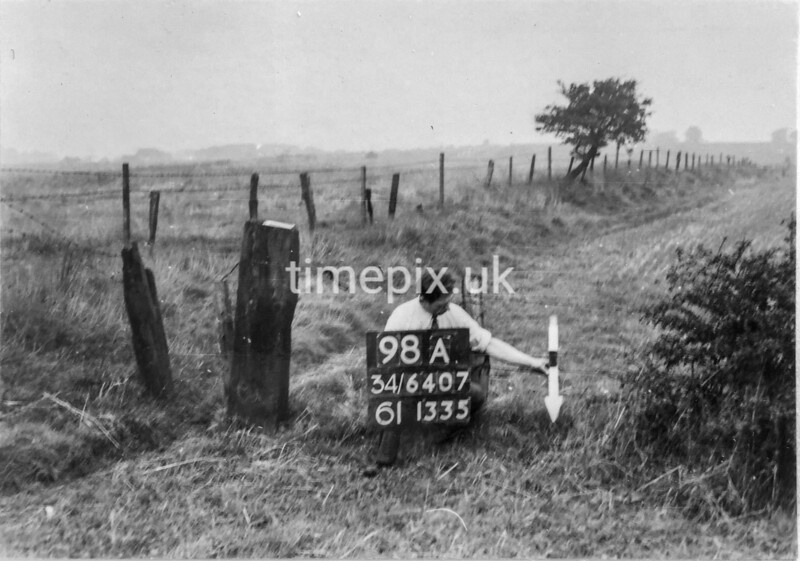 SD640798A, Man marking Ordnance Survey minor control revision point with an arrow in 1940s