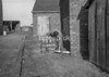 SD640475A, Man marking Ordnance Survey minor control revision point with an arrow in 1940s