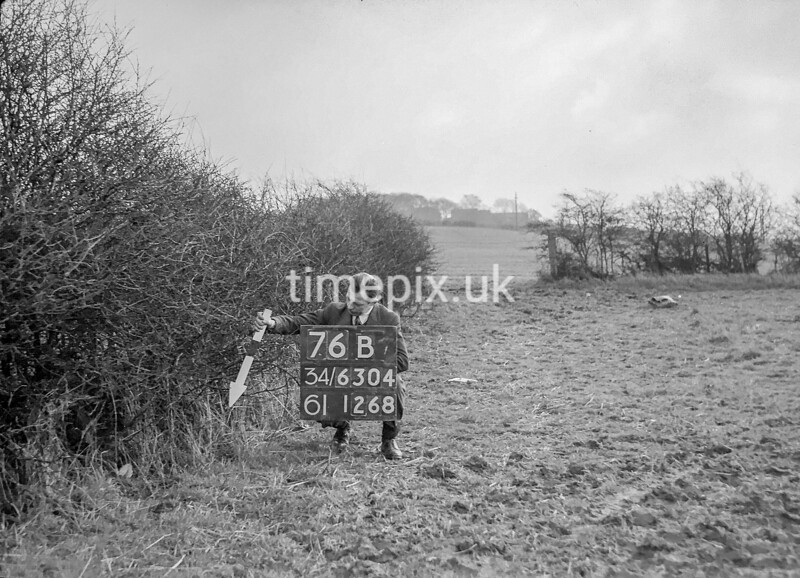 SD630476B, Man marking Ordnance Survey minor control revision point with an arrow in 1940s