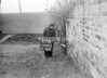 SD640567A, Man marking Ordnance Survey minor control revision point with an arrow in 1950s