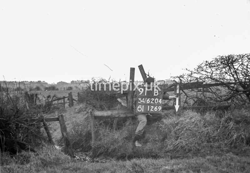 SD620491B, Man marking Ordnance Survey minor control revision point with an arrow in 1940s