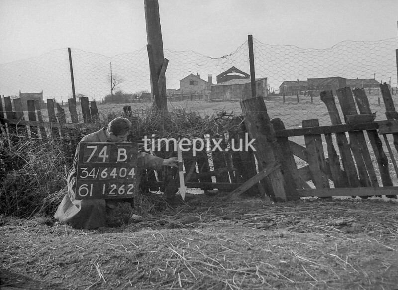 SD640474B, Man marking Ordnance Survey minor control revision point with an arrow in 1940s