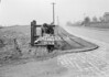 SD630779A, Man marking Ordnance Survey minor control revision point with an arrow in 1950s