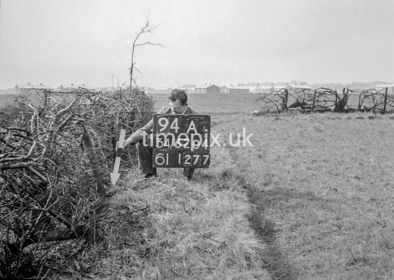 SD620494A, Man marking Ordnance Survey minor control revision point with an arrow in 1940s