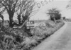SD640894K, Man marking Ordnance Survey minor control revision point with an arrow in 1940s