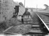 SD640544R, Man marking Ordnance Survey minor control revision point with an arrow in 1940s