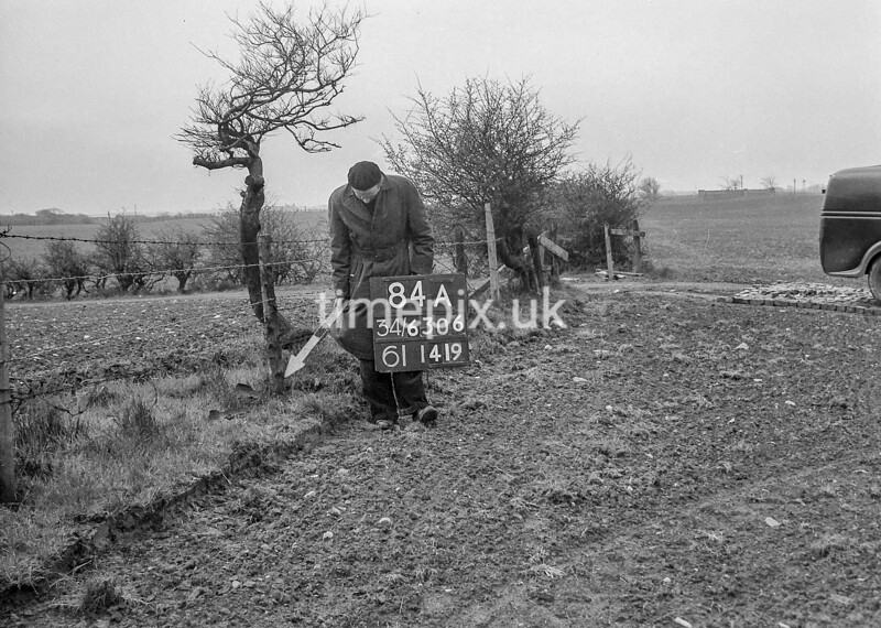 SD630684A, Man marking Ordnance Survey minor control revision point with an arrow in 1950s