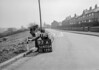 SD620497A, Man marking Ordnance Survey minor control revision point with an arrow in 1940s