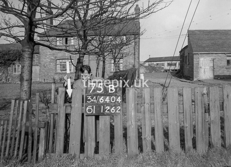 SD640475B, Man marking Ordnance Survey minor control revision point with an arrow in 1940s